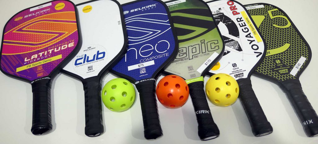 Pickleball paddles and balls.